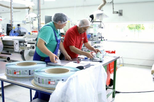 men working on packaging materials