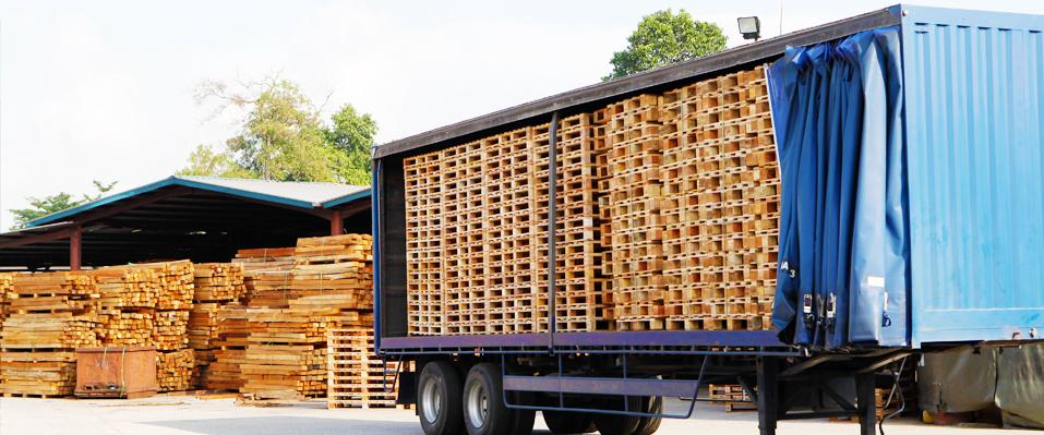 lorry with wooden pallets stacked inside