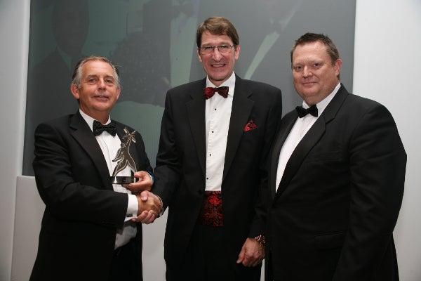 Endoline managing director and chairman Alan Yates receiving award